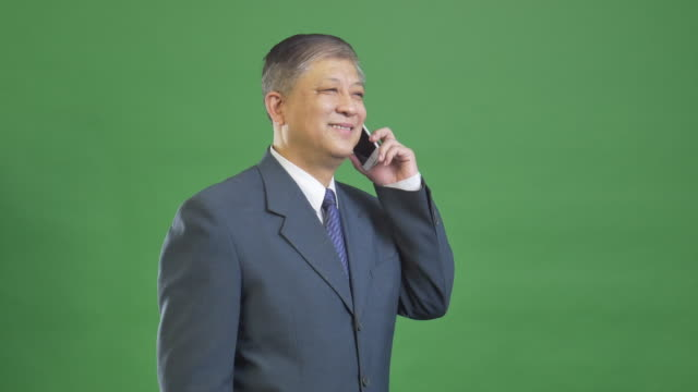 old Asian businessman in grey suit 4k