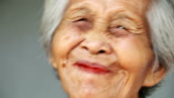 Old asian women with beetle nut in mouth