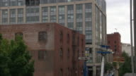 MS Old brick warehouse with office building in background in Pearl District / Portland, Oregon, USA