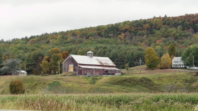 Old country barn in Vermont with fall foliage