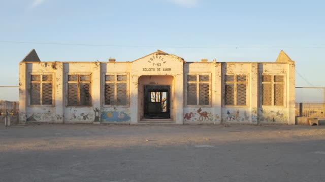 WS T/L Old degraded school with sunset light / Pedro de Valdivia, Atacama desert, Chile