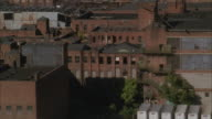 LOW AERIAL, TU, Old factories and warehouses, Manhattan skyline, New York City, New York, USA