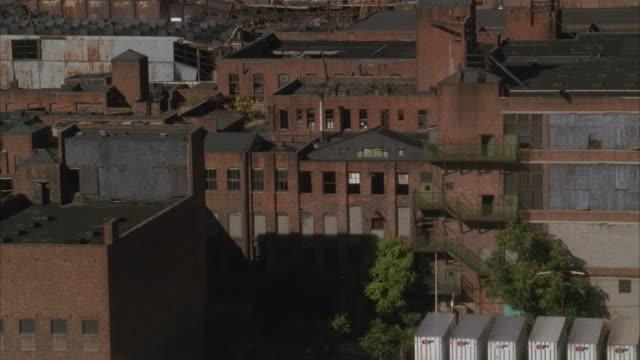 LOW AERIAL, TU, Old factories and warehouses, Manhattan skyline, New York City, New York, USA
