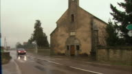 WS Old farmhouse with car passing by / Burgundy, France