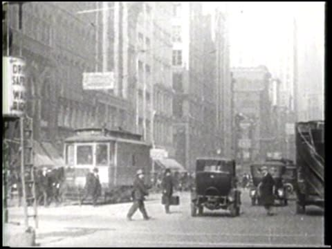 Old footage of busy crowded streets and a Bank of Italy