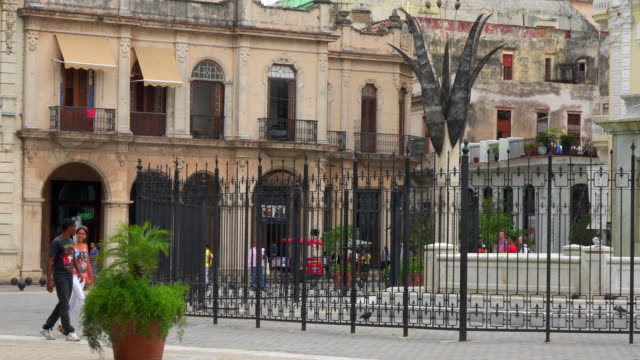 Old Havana, Cuba: Old Plaza or 'Plaza Vieja' colonial buildings and lifestyles in the daytime