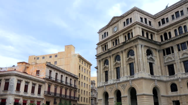 Old Havana, Cuba: Tilt up from the Saint Francis of Assisi square to the former Stock Exchange Building
