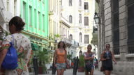 Old Havana, Cuba: Tourists walking the streets of the Unesco World Heritage Site and sightseeing the old colonial style architecture