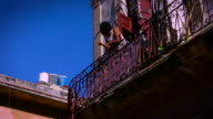 old havana cuba woman smoking on balcony in day