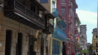Old Havana, Cuba: Zoom out from colourful buildings including the 'Hotel Ambos Mundos' (pink building)