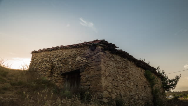 Old house of rock and stones timelapse of sunset in a little town of spain cuenca