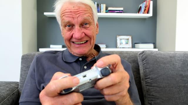 Old man playng video games