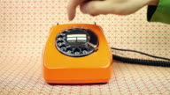 old orange telephone - dial phone number