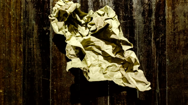 old paper ball unwrapping stop motion