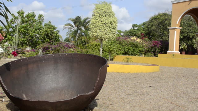 Old rusted bucket for rain water at old Plantation House in Manaca-Iznaga in Trinidad Cuba in the Caribbean