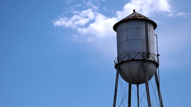 Old Rusty Water Tower on Perfect Blue Sky