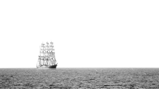 Old sailing ship in full sail in the sea