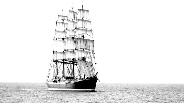 Old sailing ship in full sail