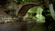 Old Stone Arch Bridge on spring