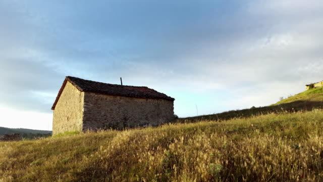 old stone house in castilla de la mancha Spain time-lapse sunrise in a hill