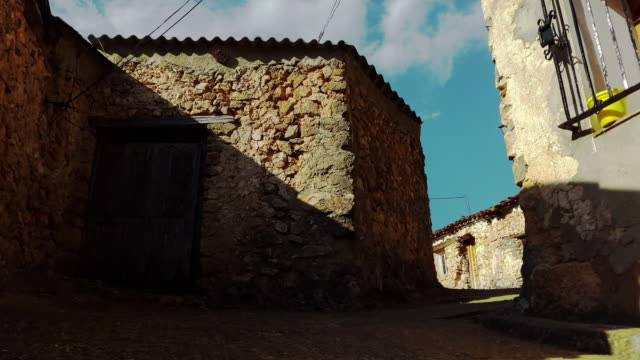 old stone houses in castilla de la mancha spain little town called tejadillos time-lapse at sunset