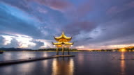 old style architecture in west lake at twilight time lapse