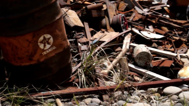 Old Texaco barrels and other scrap abandoned in Amazonian dumpster