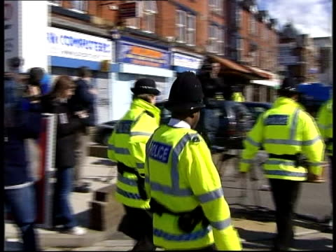 Ten arrested ITN ITN ENGLAND Manchester EXT Police officers along at scene of arrests PAN Dolphins kebab shop PULL OUT police guarding entrance as...