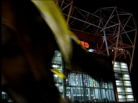 Old Trafford terrorist threat ITN Manchester Old Trafford Old Trafford Mounted police along with neon Manchester United sign in b/g Fans along from...