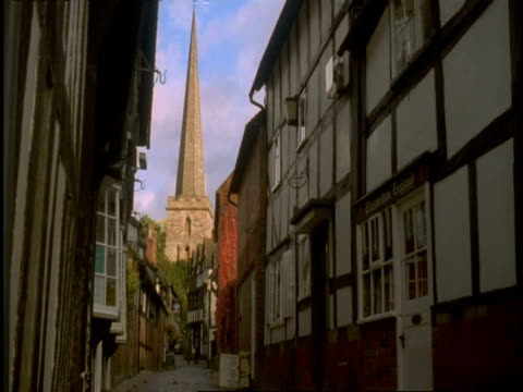 Old Tudor Buildings, Ledbury, Herefordshire - houses in narrow street, church spire at end of street