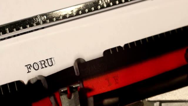 old typewriter write the word forum