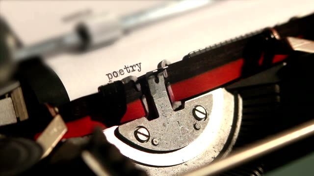old typewriter write the word poetry