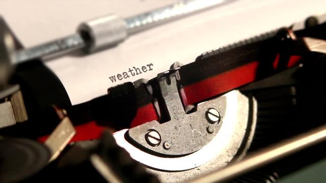 old typewriter write the word weather