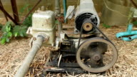Old water pump, close-up to belt and wheel.