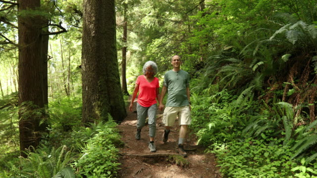 SLO MO Older couple going on a hike in the woods
