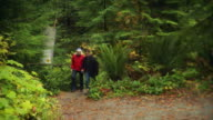 WS Older couple walking on trail through Stanley Park / Vancouver, British Columbia, Canada