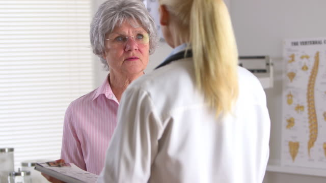 Older patient talking to female doctor