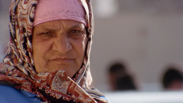 CU PORTRAIT Older woman scowling at camera/ Egypt