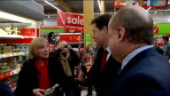 Nick Clegg visits Asda store ENGLAND Lancashire Oldham EXT Nick Clegg MP and Elwyn Watkins along in Asda supermarket store chatting to staff and...