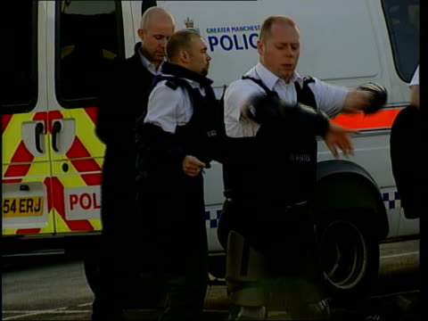 Aftermath ITN ENGLAND Oldham Police officers putting on body armour