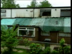 Oldham unrest Fire bomb attack ITN ENGLAND Greater Manchester Oldham EXT GVs Home of Riaz Ahmad damaged in firebomb attack BV Firefighters along to...