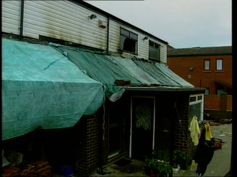 Oldham unrest Fire bomb attack ITN ENGLAND Greater Manchester Oldham EXT Home of Riaz Ahmad damaged in firebomb attack Councillor Mohammed Azam along...