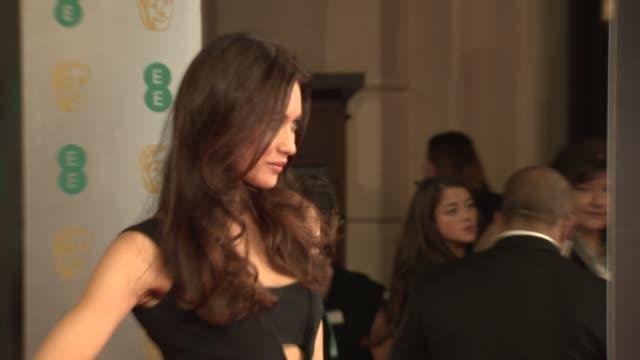 Olga Kurylenko at EE British Academy Film Awards at The Royal Opera House on February 16 2014 in London United Kingdom