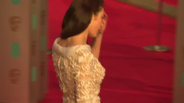 Olga Kurylenko at The EE British Academy Film Awards at The Royal Opera House on February 14 2016 in London England