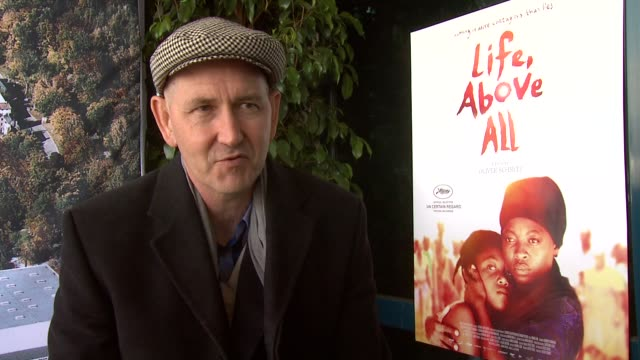 Oliver Schmitz on the film not being an AIDS movie but it shows the consequences of it at the Life Above All Interview Cannes Film Festival 2010 at...