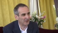 Olivier Assayas on having to do a lot of takes if the first take doesn't work at the Carlos Interview Cannes Film Festival 2010 at Cannes