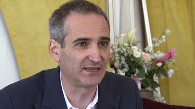 Olivier Assayas on how he got what he wanted really fast and on how it was done on a small scale at the Carlos Interview Cannes Film Festival 2010 at...