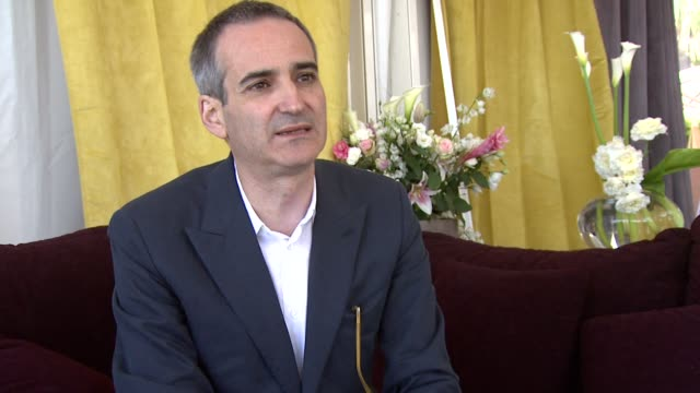 Olivier Assayas on how he was scared by the length and the languages at the Carlos Interview Cannes Film Festival 2010 at Cannes