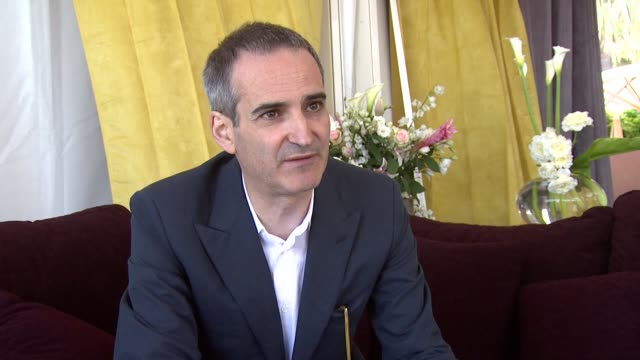 Olivier Assayas on how the film was financed by TV and that's how it became so long at the Carlos Interview Cannes Film Festival 2010 at Cannes