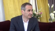 Olivier Assayas on the story of Carlos and how he represents 70s political idealism at the Carlos Interview Cannes Film Festival 2010 at Cannes